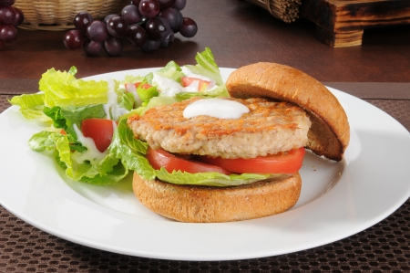 a health turkey or chicken burger with a salad
