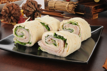 A plate of ham and salmon cream cheese wraps