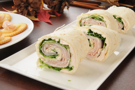 A party tray of ham and cheese pinwheels