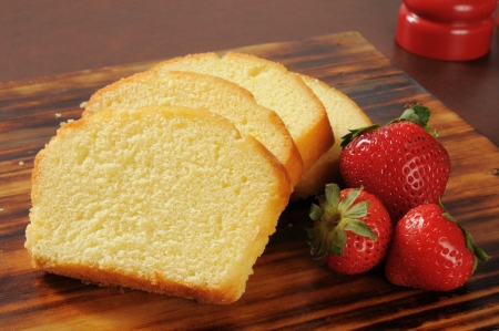 Slices of rich moist pound cake with fresh strawberries