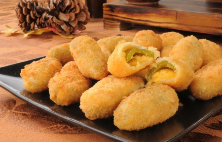 A plate of jalapeno cheese sticks on a holiday table