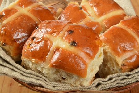 A basket of hot cross buns closeup, a food associated with Good Friday