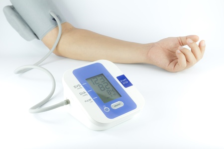 Man checking blood pressure isolated over white