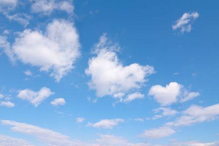 Photo pour Beautiful blue sky with some romantic heart shaped clouds. - image libre de droit