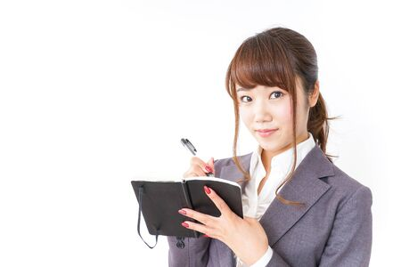 Photo for Business woman taking notes - Royalty Free Image