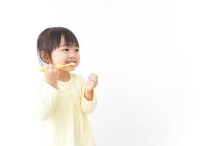 Photo for A child brushing her teeth - Royalty Free Image
