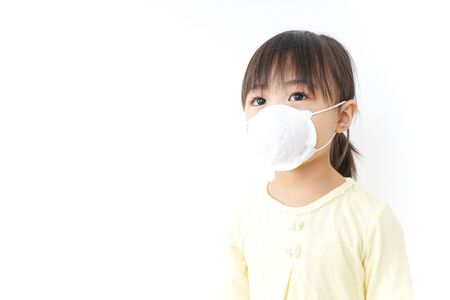 Photo for A child wearing a face mask - Royalty Free Image