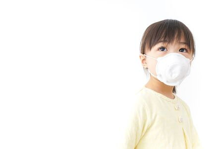 Foto per A child wearing a face mask - Immagine Royalty Free