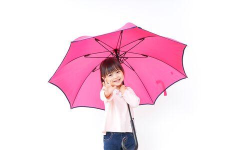Photo pour A child opening an umbrella - image libre de droit