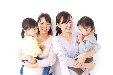 Foto für Two mothers carrying  children in their arms - Lizenzfreies Bild
