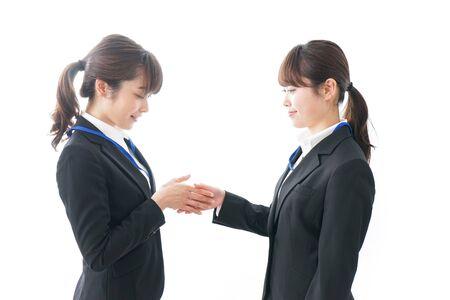 Photo pour Businesspersons shaking hands - image libre de droit