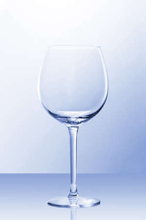 Photo pour An empty red wine glass in slightly blue light with a reflection from POV - image libre de droit