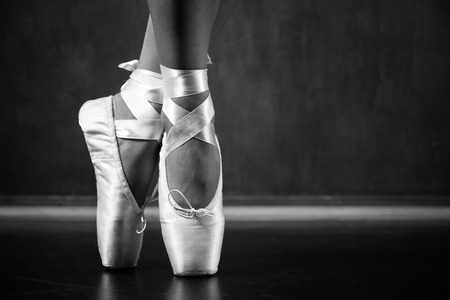 Young ballerina dancing, closeup on legs and shoes