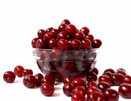 transparent bowl with ripe and delicious cherries, sweet summer fruits