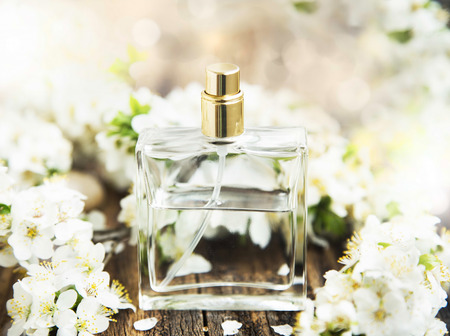 Flower Perfume in Transparent Bottle with Spring Blossomの写真素材