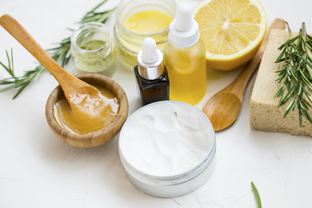 Photo pour Natural organic spa ingredients with manuka honey, essential oil bottle, clay powder ,body lotion, bath salt, rosemary branches, natural soap, lemon - image libre de droit