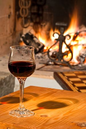 Fireplace & glass of red wine