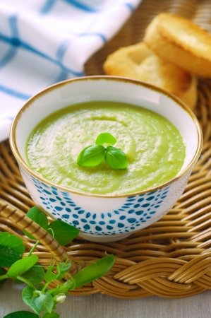Fresh green pea soup on a tray