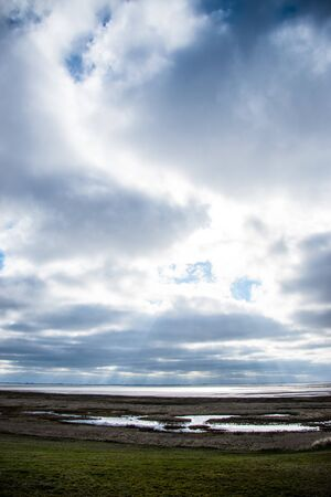 Photo for rays of sun through clouds above the sea - Royalty Free Image