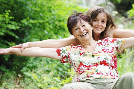 Photo for Mature woman has happy time with her daughter in nature - Royalty Free Image