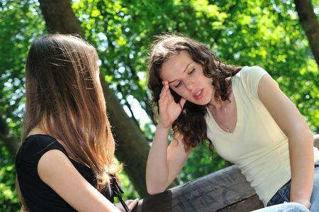Photo pour Friends series - one teenage girl comforts another which has serious problem - image libre de droit