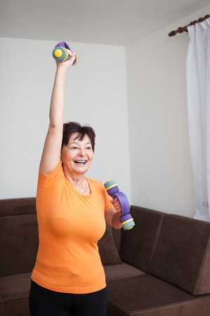 Senior woman exercising with barbellsの写真素材