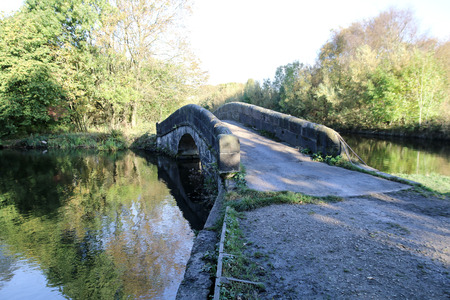 A small hump backed stone canal bridge helps the walkers and cyclists bypass the water