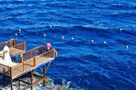 Life guard on duty in blue ocean