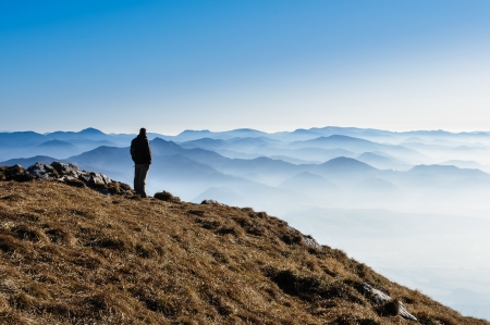 Misty mountain hills and silhouette of a man