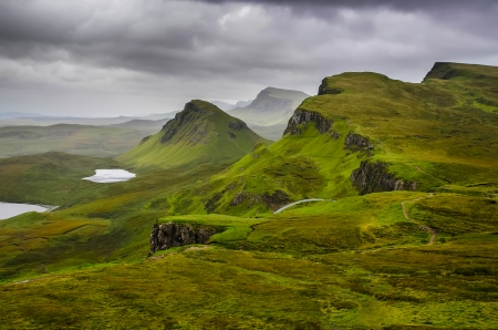 Scenic view of Quiraing mountains with dramatic sky in Scottish highlands, Isle of Skye, United Kingdom