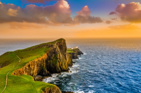 Colorful ocean coast sunset at Neist point lighthouse, Scotland, United Kingdom