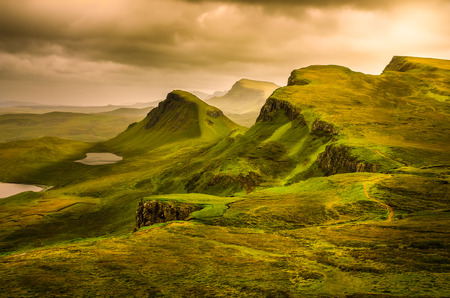 Scenic view of Quiraing mountains sunset with dramatic sky in Scottish highlands, Isle of Skye, United Kingdom