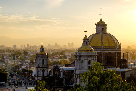 Photo pour Scenic view at Basilica of Guadalupe with Mexico city skyline at sunset, Mexico - image libre de droit