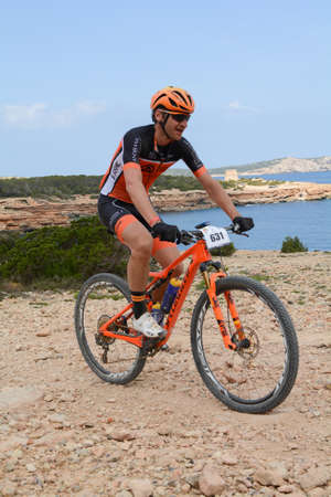 Cala Tarida, Ibiza, Balearic Islands, Spain : 2017 abril 17 : Cyclists in VUELTA IBIZA BTT 2017 in Ibiza, Andorra. Amateur race in Ibiza.