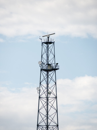 transmitter tower. radar lines with sky in background