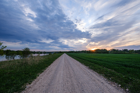 Photo pour dirty gravel countryside gravel road in summer, colored nature - image libre de droit
