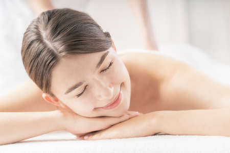 Photo for Young woman receiving a massage at a beauty salon in a bright atmosphere - Royalty Free Image