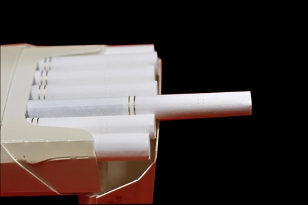 The opened pack of cigarettes on a black background