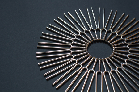 Photo for Tuning fork round pattern on a black background - Royalty Free Image