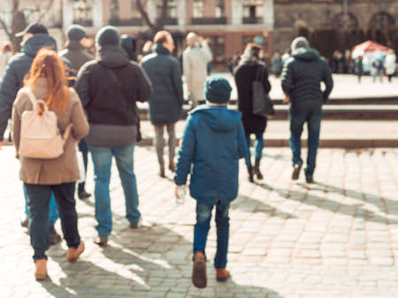 Photo pour Blurred background. Blurred people walking through a city street. The photo is made out of focus, no faces are recognisable - image libre de droit