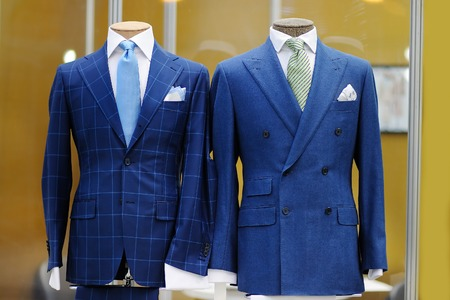 Beautiful blue suits with tie, tie clip and handkerchief on a mannequin