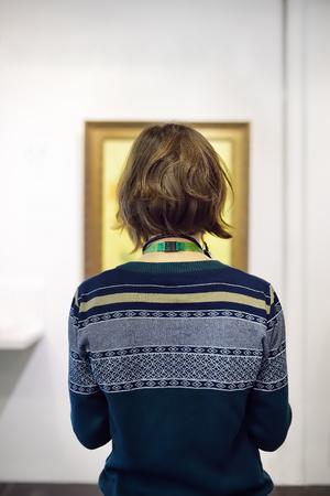 Foto de Visitor looks at the paintings by Vincent van Gogh in the Museum Van Gogh in Amsterdam, Netherlands. - Imagen libre de derechos