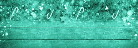 Foto de Merry Christmas and Happy New Year. Christmas Decorative Ornate Fir Glitter Natural Gifts and sweets on wooden Background. Red Holiday Concept. - Imagen libre de derechos