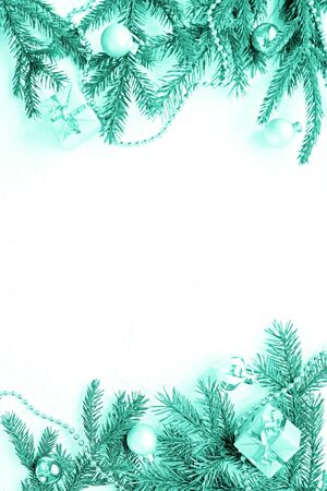Foto de Merry Christmas and Happy New Year. Christmas Card Festive with green Fir Branches and Holiday gold Object on white Background. Snowflakes - Imagen libre de derechos