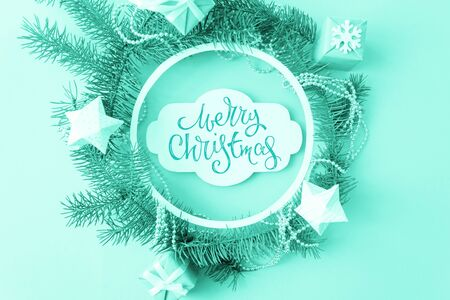 Foto de Merry Christmas theme with round frame with branches firtree, gifts, pine cones. - Imagen libre de derechos