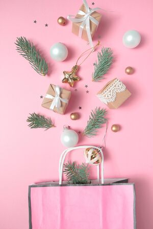 Photo for Package with different christmas gold and white decoration on pink background. Flat lay. the concept of the Christmas fair - Royalty Free Image