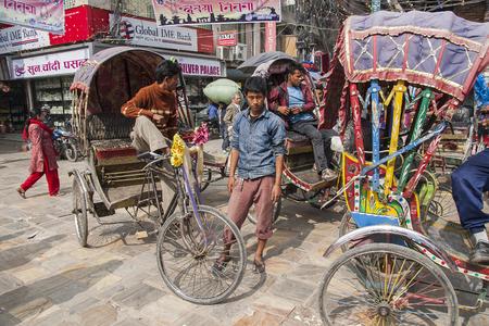 KATHMANDU, NEPAL – CIRCA OCTOBER 2013: rickshaw is a very popular means of public transport in cities in Nepal circa October 2013 in Kathmandu.
