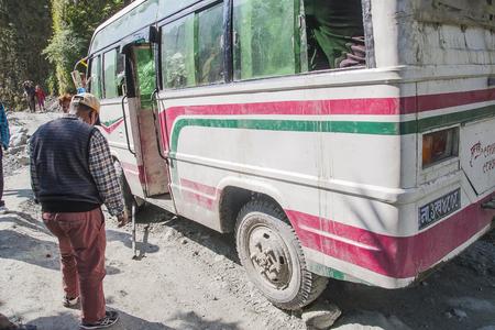 KALAPANI, NEPAL - CIRCA NOVEMBER 2013: failure of the bus on a bumpy road Nepalese circa November 2013 in Kalapani.