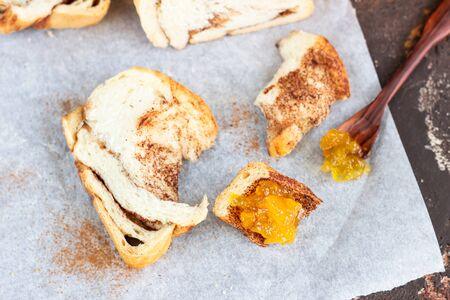 Photo for Slices of homemade cinnamon babka or swirl brioche bread. Cinnamon roll bread. Povitica: traditional Polish sweet bread. Old brown concrete background. - Royalty Free Image