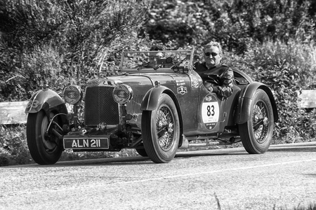 PESARO COLLE SAN BARTOLO, ITALY - MAY 17 - 2018: ASTON MARTIN LE MANS 1933 on an old racing car in the Mille Miglia rally 2018 the famous italian historical race (1927-1957)